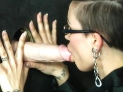 Spex babe drenched in thick loads of jizz
