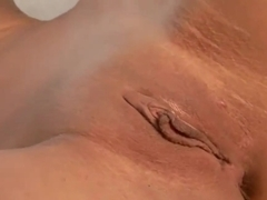 Big tittied hottie is masturbating so well